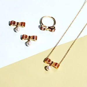 Henri Bendel Stripe Bow Pearl Earrings